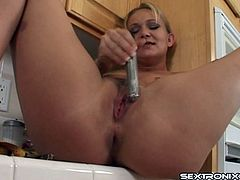 Babe on the kitchen counter shoving a toy in her asshole