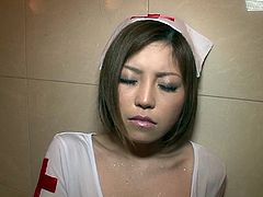This kinky nurse costume really suits naughty Hikaru. The incredibly attractive Japanese slut gets wet, under the shower. The dress she's wearing and those white sexy stockings, are a huge turn on. Watch the guy using a vibrator to spice things up!