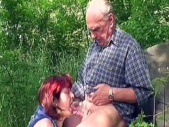 Chubby granny in a neck brace fucks her husband by the lake