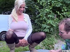 Horny German milf needs to piss and stops near the lake to suck cock, and take it up her ass. And all over her big round tits.