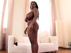 Darky with big melons and clean muff is totally naked and plays with her pussy hole non-stop