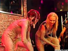 Teen girls in sexy dresses enjoy a good mud wrestling