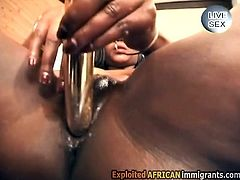 Hot slutty ebony uses a sneaky vibrator to stretch her own