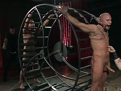 This foursome is all about bondage, in this case being a little bit of pain and some pleasure. Sebastian and his buddy Christian, have a big wheel to tie Eli and Scott to in order please and punish them.