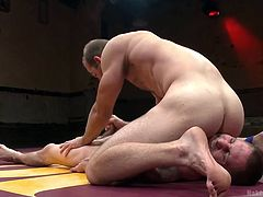Beating your opponent in the Naked Kombat arena isn't just about a pinfall or submission. Just like Ultimate Surrender, humiliation is always smiled upon, like Jay does to Jonah here. He does jerk him off, but while he's sitting on his face and dragging his nuts up and down it.