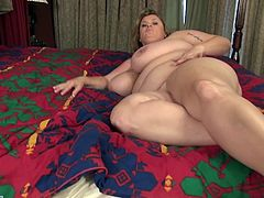 BBW Kimmie Kaboom is feeling horny again, but no man is here to fuck her. Dildo is not enough for her big ass. She needs a man to hold her enormous tits. Her pussy is wet and ready to be drilled deep and hard. She wants to press your cock between her tits and take your load on them.