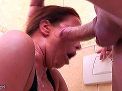 Mature toilet slut pissing and gagging on cock