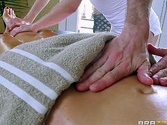 Nikki Benz was getting massaged by Riley Ried, who is a professional masseur. In between the session, Danny joined them and the horny brunette couldn't control herself, after seeing the muscled stud. While getting massaged, she took his big tool in her mouth and offered him a pleasurable blowjob.