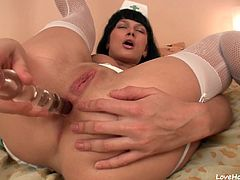 Gorgeous nurse penetrates her own depths with toys