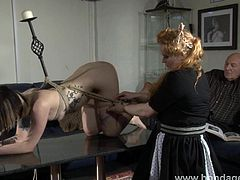 Amateur lezdom ties her pretty goth subbie up with ropes on the living room coffee table