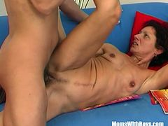 Horny redhead mom sucks and fucks stepson after catching him with porn magazine in the couch.