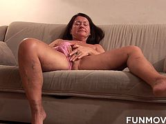 German redhead horny granny gets exactly what she was looking for, a huge dildo that she can satisfy her old shaved wet pussy.