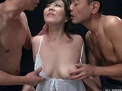 Lucky Japanese model finds herself surrounded with the thick dicks