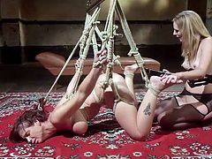 Mona is all tied up, the busty beauty bent over with nowhere to go. She's at Syren's mercy, but no mercy comes here. She fingers her friend and eventually, just shoves her whole hand in the bound babe's pussy.