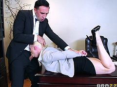 Nikki's boss was not happy with her work, but he could not refuse her sex proposal. She laid down on table, grabbed his cock and made him horny with blowjob. He tied her with belt, removed her clothes, sucked her big juicy melons and fucked her mouth brutally...