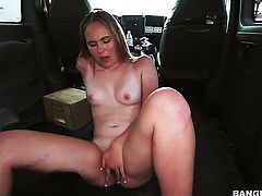 Blonde shows off her assets while giving tug job
