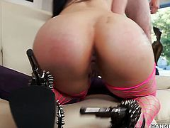 Brunette goddess with gigantic tits gives stroke job to one lucky man