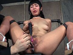 Of course, she can only cum with her executor's permission, as he is the one that put her into this bondage in the first place. He tantalizes her with his arsenal of toys, including a curved metal pussy hook and some vibrators.