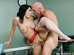 Valentina Nappi with gigantic jugs has fire in her eyes as she gets her mouth fucked by Johnny Sins