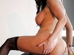 Brunette Nikki Benz with giant boobs turns Danny D on to the point of no return before cock sucking