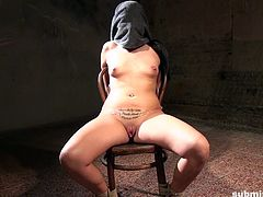 Clair, Clair, tied to a chair. She's gagged and hit with a vibrator right on her exposed pussy. After that, her head is covered, as her executor does not want her to see, what he will bring to make her explode next.