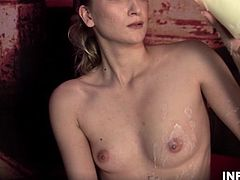 Fantastic skinny blonde babe with hot body enjoys BDSM action. Hottie adores fucking her wet pussy with a huge dildo as she enjoys herself enormously.