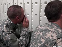 Soldiers in gas masks are in a small room, training for bad situations. They sit as they're supposed to, and even jerk or suck the cocks, that find their way to the other side of the gloryholes around the building.