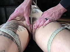 Leigh Raven is new to BDSM and the dominant master started the hardcore session with wax torture. With every drop of hot wax dripping on to her body, her moans increased and she tried her level best to move. Later, he placed a vibrator on her clit, but didn't allow to moan.