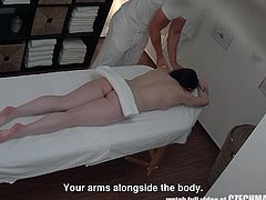 He started by slowly rubbing oil all over her soft skin. This masseur certainly knows how to help a beautiful woman relieve all her tension. He fingered her pussy and shoved his cock into her warm snatch.