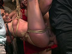 Lilith is bound up in this room, with many around to watch as she is tied up, humiliated, and fucked. Will the spectators remain that way, or will any of them get to join in the fun? Find out, when you watch the video below!
