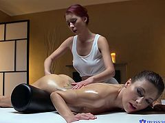 Pretty babe Paula has magic fingers that can give more than just a good massage. She does such a great job of rubbing tempting Talia's oiled body, that they both become unbearably turned on. They take turns licking each other's perfect tits, and fingering each other's moist pussies.