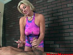 Smoking femdom masseuse tugging clients cock