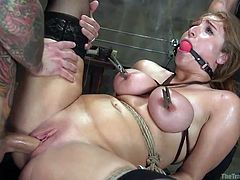 To achieve the best results, she had to be trained by the masters. They use electric prods on her clit, while she is bound and gagged in the sex dungeon. The pain leads to intense pleasure as she is stimulated by the doms.