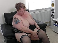 This fat mature lady has a sweet ass. She strips and shows off her fat curves and natural tits. The fatty takes out her favorite dildo and shoves it deep into her wet cunt. Watch as she makes herself cum hard.