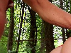 Blonde-haired Russian hottie Isabella Clark dressed in red has great outdoor sex in the park. She sucks stiff cock beside a bench and then gets her tight pink hole penetrated from behind.