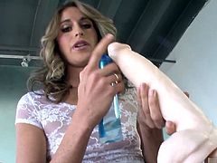 Kara Price is all dressed up in white lace to demo a massive dildo. This monstrosity is so big, it takes more than one hand to hold, and Kara cant even wrap her mouth around the tip Thats ok, though, she just lets her spit drip down the shaft to lube it up for its penetration between her labia. Kara tries it from several angles, finally settling for the deeper thrusts, because shes determined to get fucked silly