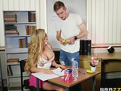 She may have detention, but she really can't focus on her studies. Instead, all she wants to do is suck on this stud's massive cock. She pulls her big tits out and sucks this lucky guy, until he is ready to cum hard all over her chest.