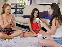 Even lesbians like to play naughty games. These cute babes were having fun playing strip poker, but that quickly turned to some hot threesome action. Casey sits on her lover's face and has her sweet cunt licked until she cums.