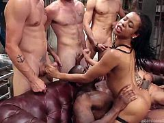 Believe me, this naughty ebony babe enjoys all these huge penises and pleasures, that they can provide her, to the fullest. She rides one huge black cock, while sucking and tugging on other hard dicks, waiting for their turn to penetrate this juicy ebony pussy.