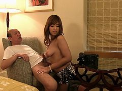 This naughty Japanese cutie is about to give gramps a rocking good time in the bedroom. She sits on his lap and lets him fondle, and squeeze her sensitive nipples. When he's all hot and aroused, she kneels and alternates between taking his hard prick in her warm mouth, and between her big tits.