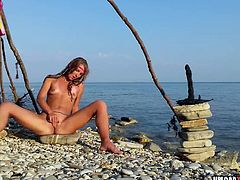 So sweet amateur chick fingering and dildoing her cunt on a beach.
