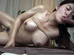 She is oiled all over and massage by his hands. This Japanese lady loves to be fingered and made to cum. She wants to orgasm for him right now. He makes her moan loud, as he rubs that hairy cunt and makes her pussy drip.