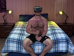 He is so horny that he puts on his virtual reality headset and watches some very hot gay sex. He imagined a sexy stud plowing the tight asshole of a gay hunk. This is way better than real sex. He will be jacking it all night.