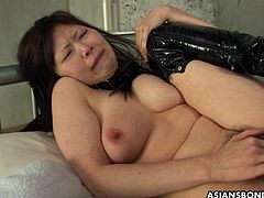 Being stripped to boots and collared, this busty Japanese babe got her hairy cunt roughly fingered and eaten while having her nipples twisted. She even used her titties to try and make his cock cum.
