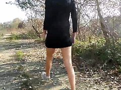 wome pissing in woods