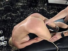 He has her bound up and tied with rope, so he can dominate her in any way he wants. She likes to be controlled, as it brings her more sexual pleasure. She is having a hard orgasm, as he pressed the vibrator on her cunt.