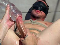 The master is using this slave's cock for his pleasure. He will not stop until this balls are absolutely milked dry by the fleshlight. The tied up slave wants free, but the mean gay Dom won't allow it to happen.