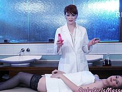 Busty lesbians massage each other in the lab