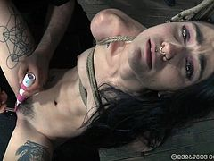 The rope is so tight around her beautiful slim body. The master has tied her up so tight that she can't move at all. The vibrator on her clit is almost too much for her to handle, but she can't do anything because she's bound.