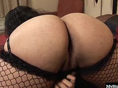 Karma is a lingerie loving brunette who has a booty that is beyond description. She shakes it, wiggles it and loves messing around with it. Her tits are pretty damn impressive as well, along with those wonderful fishnet covered legs.